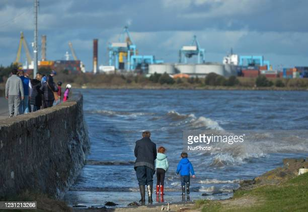 People observe the waves at Sandymount Strand, during Level 5 COVID-19 lockdown. On Tuesday, February 16 in Dublin, Ireland.