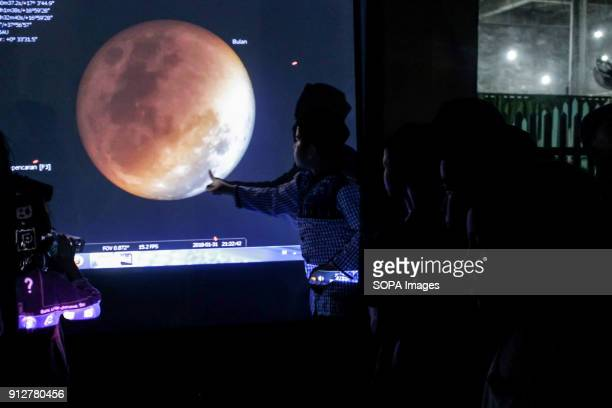 LHOKSEUMAWE ACEH INDONESIA People observed the phases of a lunar eclipse using a telescope during the lunar eclipse phenomenon in Lhokseumawe The...