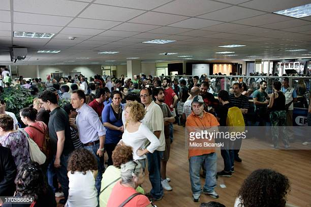 People occupy the main hall of the headquarters of the Greek public broadcaster ERT on June 12 2013 in Athens Greece Journalists have refused to...