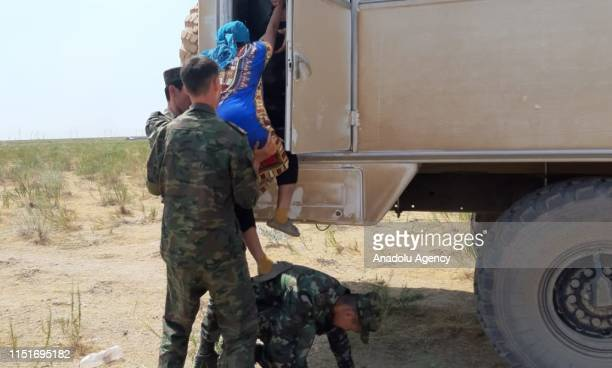 People of Arys town are evacuated after explosions at military unit, in Turkestan, Kazakhstan on June 24, 2019. A state of emergency has been...