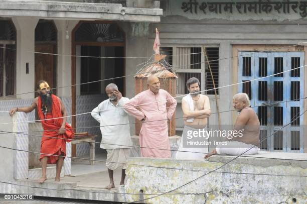 People of Ayodhya standing on their roof to see Uttar Pradesh Chief Minister Yogi Adityanath during his visit on May 31 2017 in Ayodhya India On his...