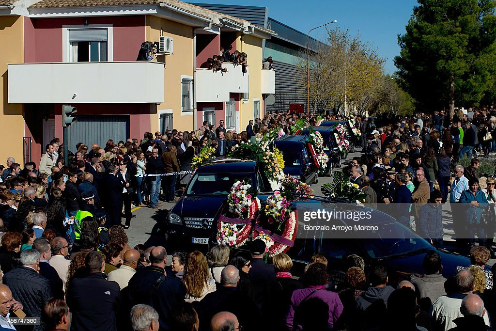 People of Bullas surround the passage of hearses leaving the funeral for the 14 victims of the recent bus accident this weekend at Juan Valera pavilion outdoor on November 10, 2014 in Bullas, at Murcia province, Spain. More than 2 thousand people attend the funerals for the 14 victims who were killed after their bus fell 15 meters from the Calasparra road. The travellers were returning from Madrid to the Murcian town of Bullas after attending a religious ceremony at the Convent of the Barefoot Carmelites.