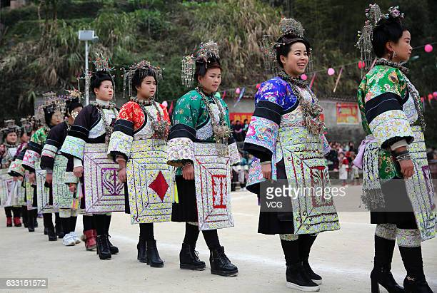 People of Dong nationality dance in a circle during the 'Caigetang' ceremony on the third day of Chinese Lunar New Year at Leti Town on January 30...