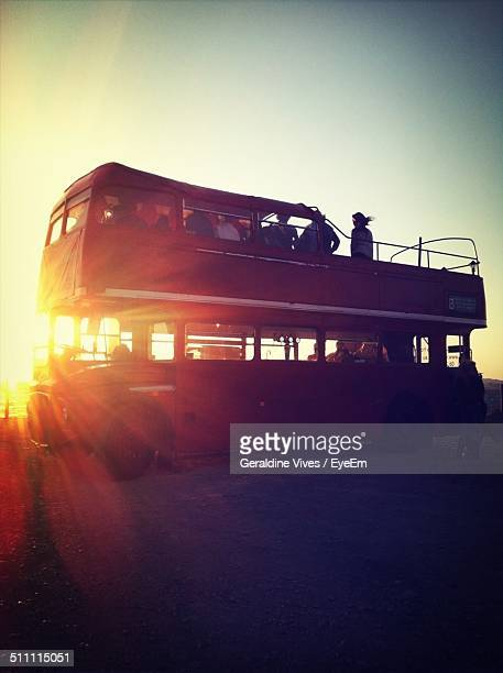 People of double-decker bus at dusk