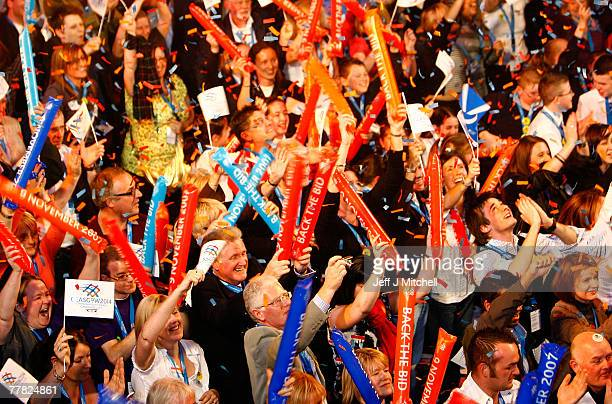 People of Glasgow react to the announcement that their city will be the venue for the 2014 Commonwealth Games, at the Old Fruitmarket November 9,...
