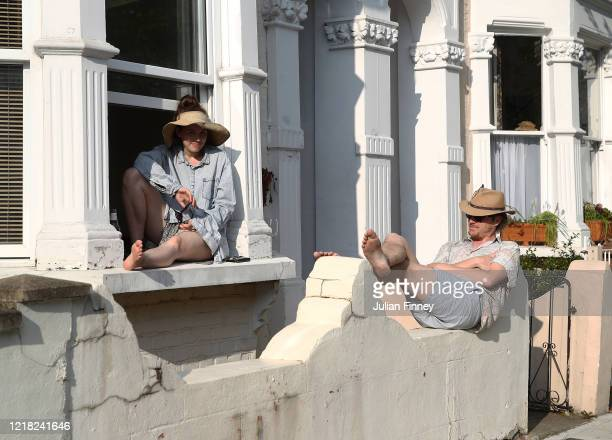 People of Hackney enjoy the outside sunshine on April 11 2020 in London England The Coronavirus pandemic has spread to many countries across the...