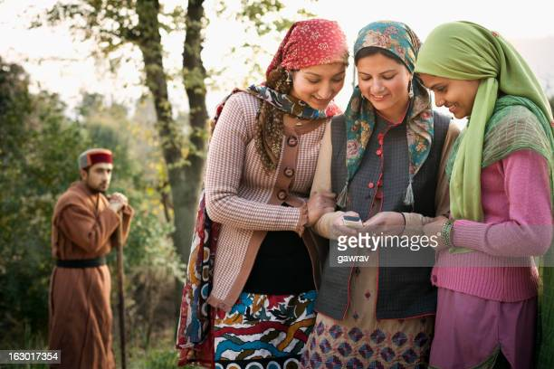 People of Himachal Pradesh: Beautiful young women using mobile p