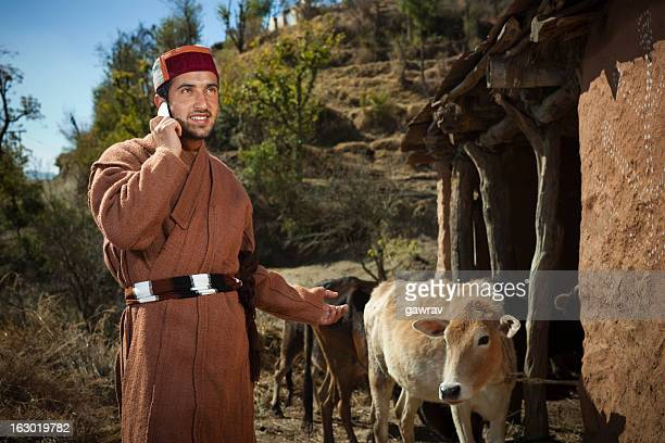People of Himachal Pradesh: Happy young man using mobile phone