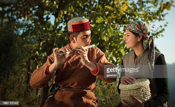 People of Himachal Pradesh: Man playing flute and woman listening