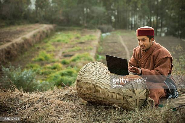 People of Himachal Pradesh: Young farmer using laptop