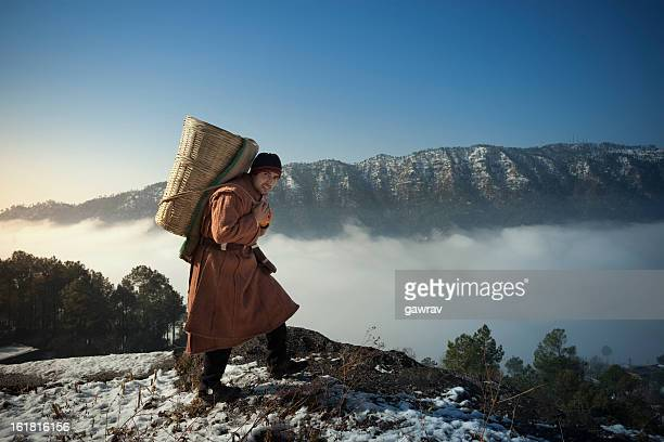 People of Himachal Pradesh: young man in snow capped mountains