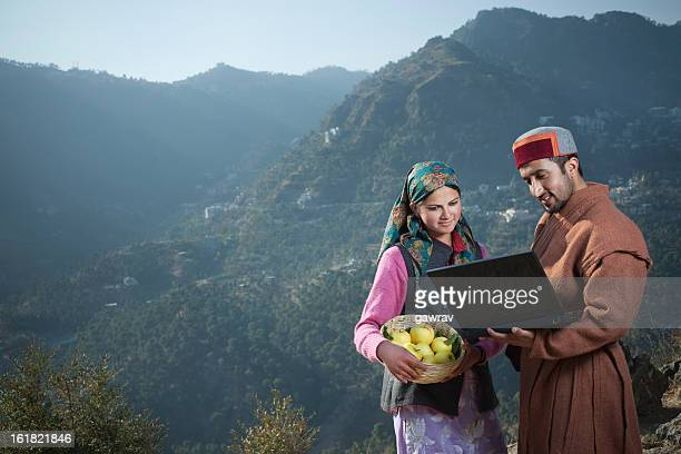 People of Himachal Pradesh: young women and man using laptop.