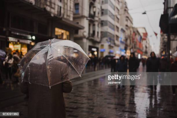 People of Istanbul are walking in a rainy day in Taksim, Istanbul,Turkey