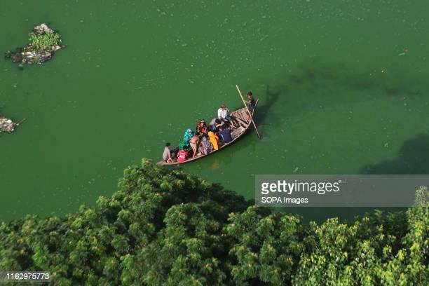 People of Korail Slum in a boat on GulshanBanani Lake in Dhaka About 40700 people lived in Korail slum the biggest slum in Dhaka