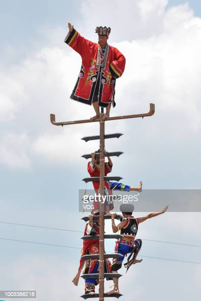 People of Miao ethnic minority climb a blade ladder to celebrate the traditional festival on the 6th day of the 6th month of the Chinese traditional...