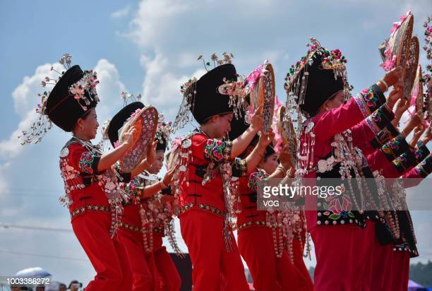 People of Miao ethnic minority group dance to celebrate the traditional festival on the 6th day of the 6th month of the Chinese traditional lunar...