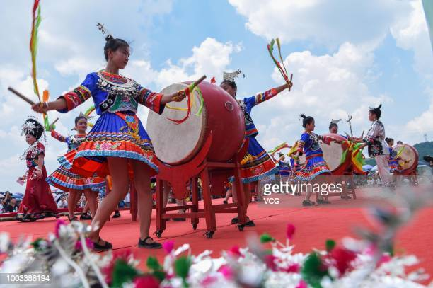 People of Miao ethnic minority group play drums to celebrate the traditional festival on the 6th day of the 6th month of the Chinese traditional...