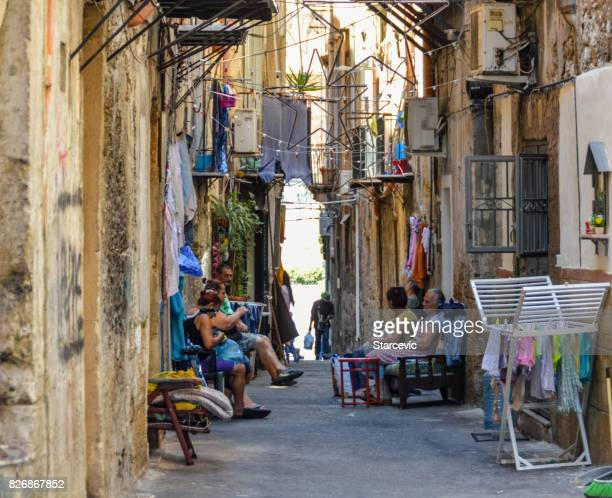 People of Palermo enjoying summer on the streets in Sicily