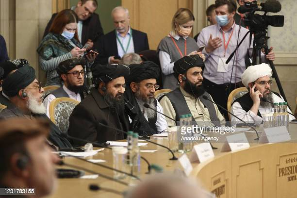 People of Taliban delegation headed by Abdul Ghani Baradar, the groups deputy leader attend a meeting on Afghan peace with the participation of...