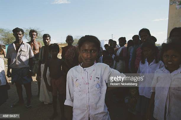 People of the Dalit or 'untouchable' class of the caste system whose homes were burned down by upper caste militia Kadayiruppu India 1997