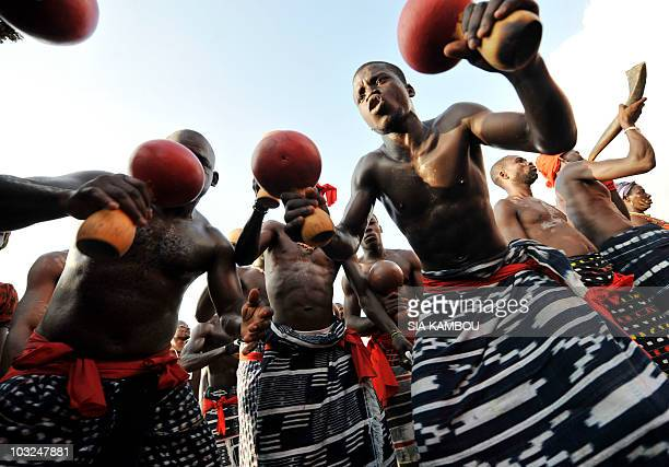 People of the Ebrier tribe take part in an exhibition dance in Abidjan on August 4 2010 as part of the 50th anniversary celebrations of the...