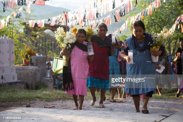 People of the Nahua community of San Francisco Ozomatlan at Guerrero Mexico on November 3 2019 visits the cemetery to remember and decesead loved ones