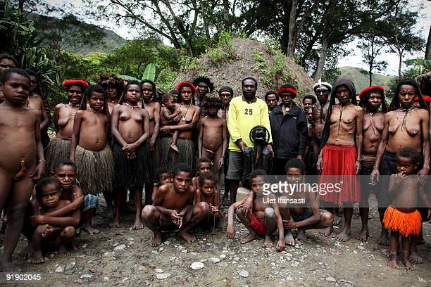 People of the traditional Dani tribe from Lembah Baliem pose for a photographer on October 10 2009 in Wamena West Papua Indonesia The primitive tribe...