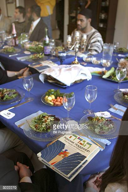 People of various faiths and nationalities attend an interfaith Passover celebration at the home of Sharona Shapiro April 5 2004 in West Bloomfield...