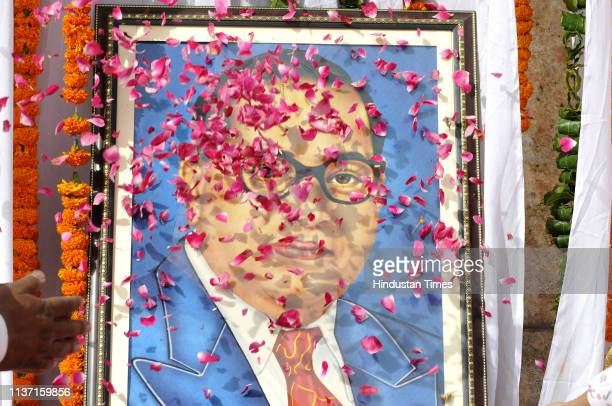 People offer floral tributes on the occasion of the 128th birth anniversary of Dalit icon BR Ambedkar at Rashtriya Dalit Prerna Sthal sector 95 on...