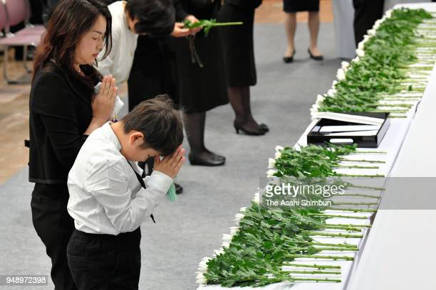 People offer flowers during the memorial ceremony on the second anniversary of the Kumamoto Earthquakes on April 14 2018 in Kumamoto Japan The first...
