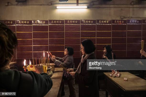 People offer incense at a temple in Hong Kong China on Wednesday Feb 7 2018 For the past seven years the travelandtourism sector has outperformed the...