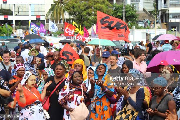 People offer Islamic prayers before the start of a demonstration in Mamoudzou in the French overseas territory of Mayotte on February 20 2018 The...