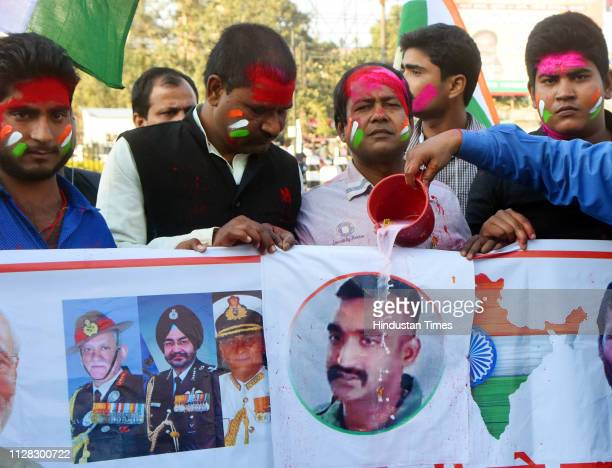 People offer milk bath to a poster of Wing Commander Abhinandan Varthaman after he is released by Pakistan on March 1 2019 in Patna India Wing...