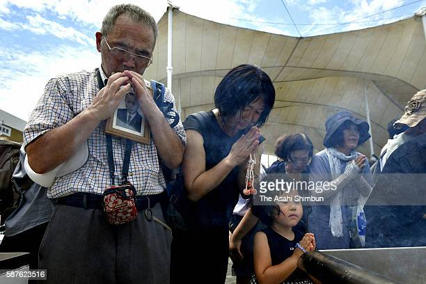 People offer prayer after the memorial ceremony on the 71st anniversary of the atomic bomb dropping at the Peace Park on August 9 2016 in Nagasaki...