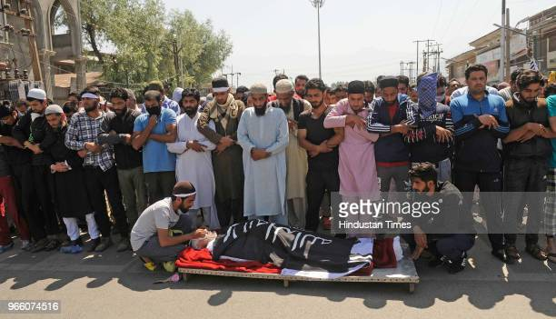 People offer prayers during the funeral of Kaiser Amin Bhat in downtown on June 2 2018 in Srinagar India Clashes erupted between protestors and...