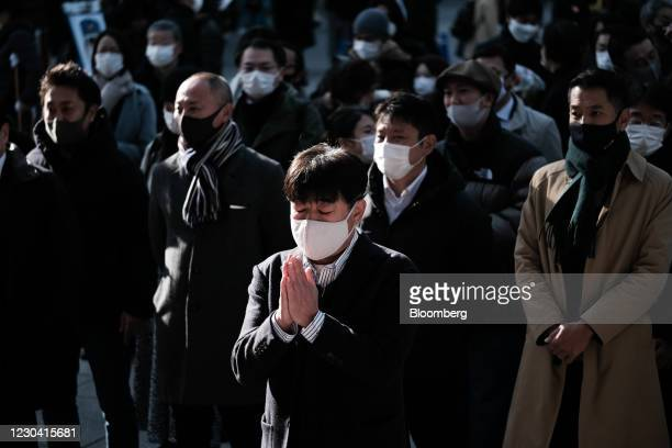 People offer prayers on the first business day of the year at the Kanda Myojin shrine in Tokyo, Japan, on Monday, Jan. 4, 2021. Japanese stocks...