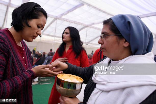 People offer prayers on the occasion of Christmas at Sacred Heart Chathedral on December 25 2017 in New Delhi India Christmas marks the annual...