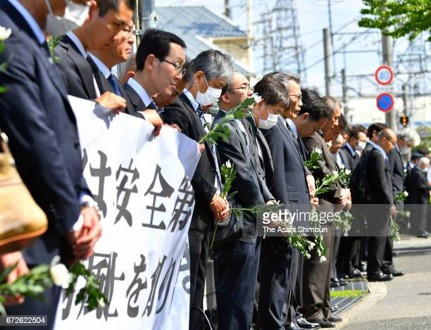 People offer the minute of silence on the twelveth anniversary of the train derailment accident on April 25 2017 in Amagasaki Hyogo Japan The worst...