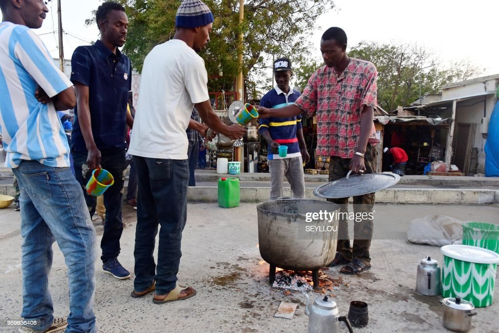 People offer traditional Senegalese drink