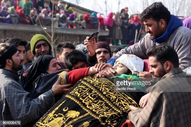 People offered funeral near the body of a 16 year old Kashmiri rebel Farhan Ahmad Wani at Redwani village of Kulgam District Tawseef a Civilian...