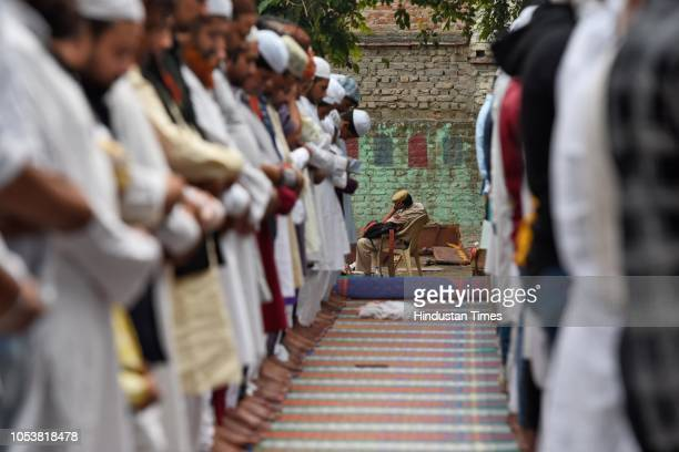 People offering Friday prayers at Jamia Faridya Jama Masjid as Policeman takes rest after an eightyearold student of a Madrasa died after he...