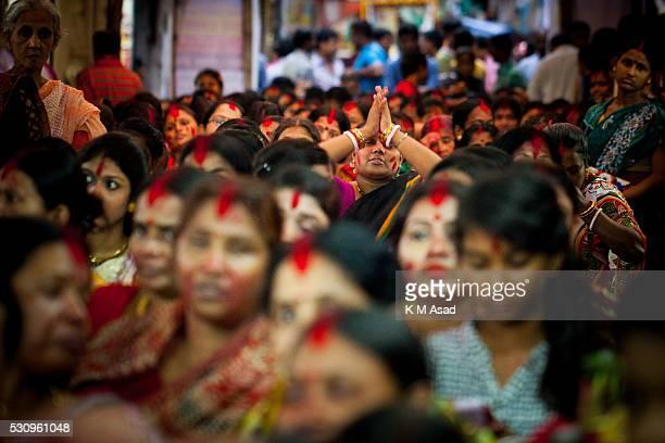 People offering pooja to Bipadtarini Devi in Dhaka Bangladesh July 25 2015 During the ritual of people from Hindu community take long day ritual and...