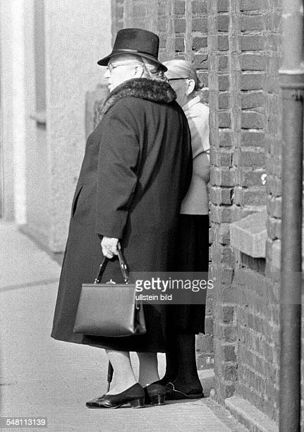 People, older woman with handbag talking with her neighbor, corpulent, aged 70 to 75 years -