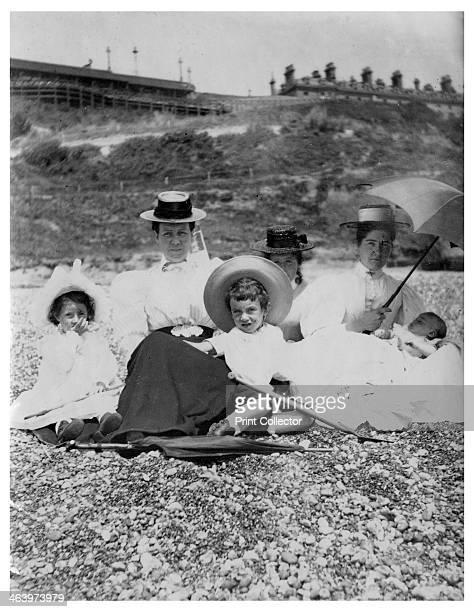 People on a beach, c1890-1909.