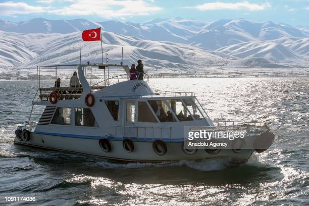 People on a boat get close to Akdamar Pier during winter in Akdamar Island on Van Lake in Turkey's eastern province Van on January 29 2019