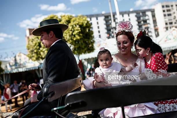 People on a horse drawn carriage during a parade at the 'Feria de Abril 2016' the traditional Seville's Fair with 169 years of history on April 14...