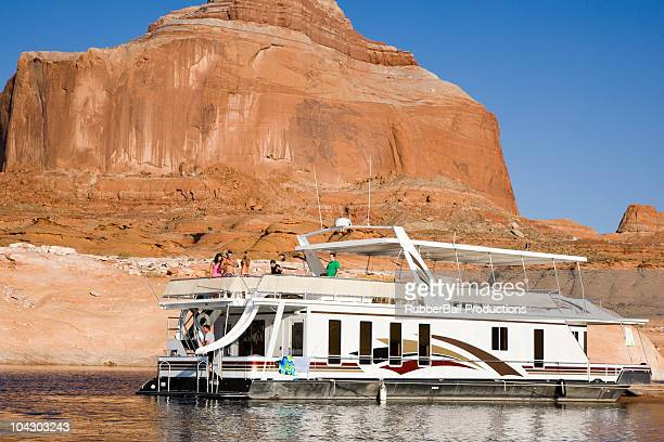 people on a houseboat on lake powell - houseboat stock pictures, royalty-free photos & images
