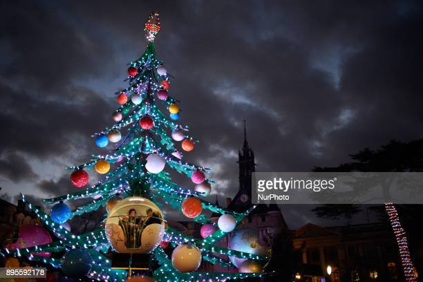 People on a merrygoround like a giant Christmas tree A Christmas market is placed on the main square of Toulouse the Capitole People come to buy a...