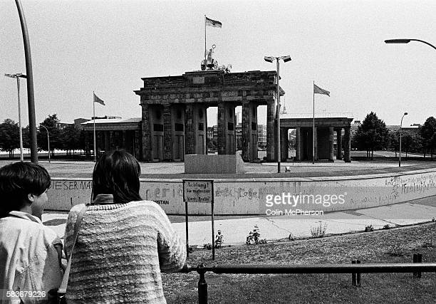 People on a viewing platform looking down on a section of the Berlin Wall at the Brandenburg Gate seen from the western side of the divide The Berlin...