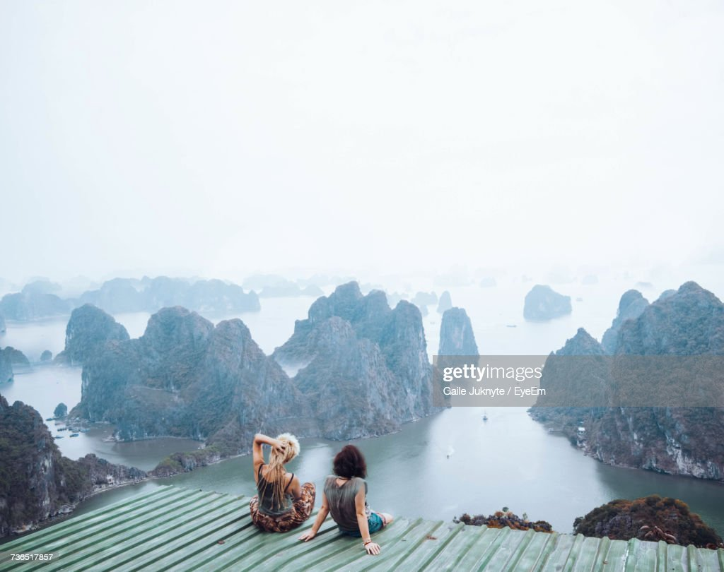 People On At Scenic Lookout Against Sky : Stock Photo